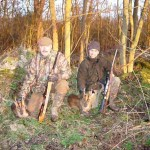 Two men with two culled Muntjac