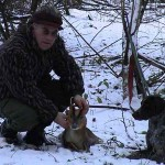 Man and hunting dog in snow with Muntjac cull